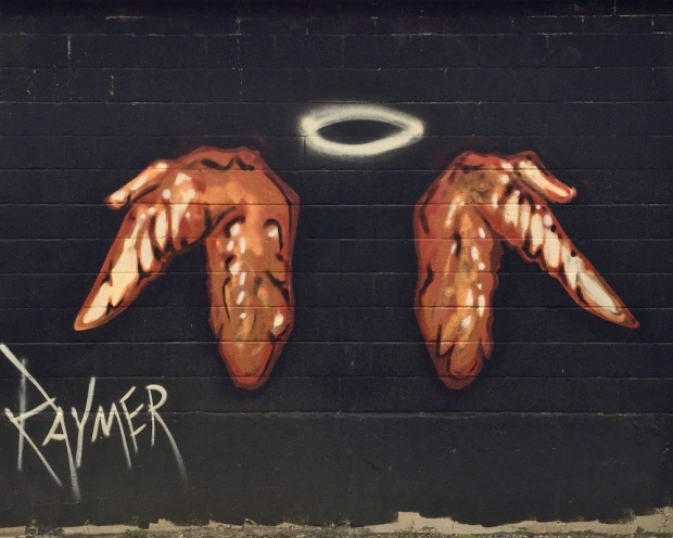 mural of chicken wings with an angel's halo painted by artist Jeremy Raymer