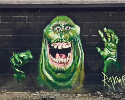 mural of green monster by artist Jeremy Raymer