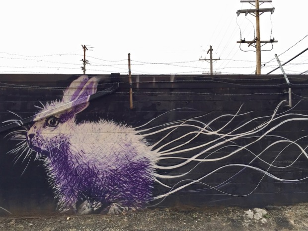 mural of purple bunny by artist Jeremy Raymer