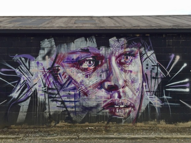 mural of man's face by artist Jeremy Raymer