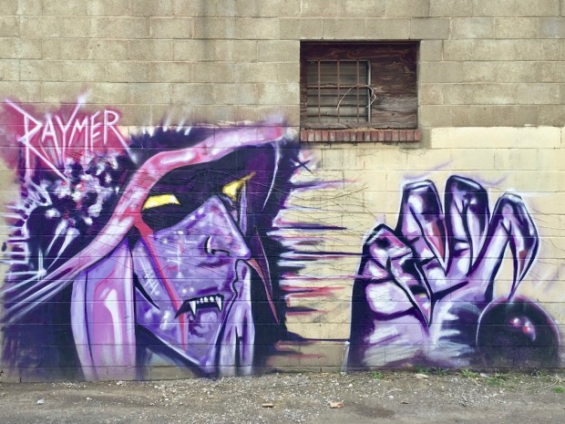 mural of purple witch painted by artist Jeremy Raymer