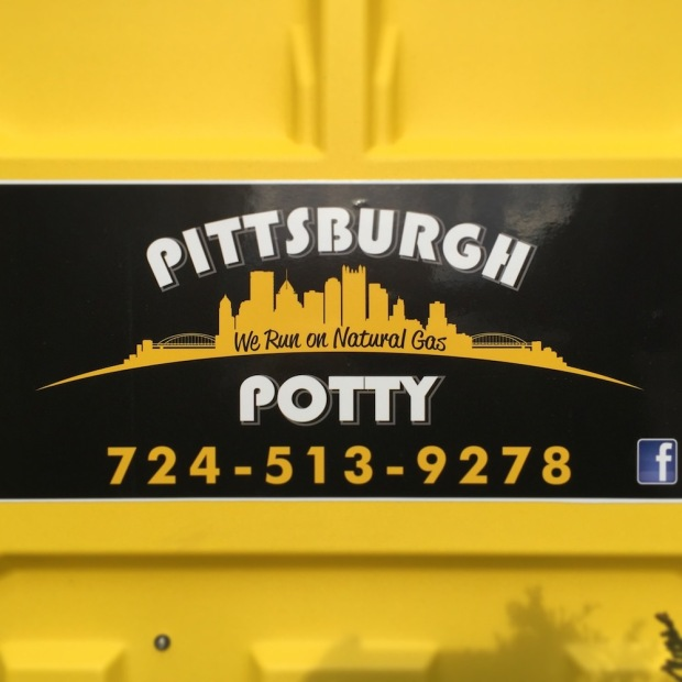 "logo for Pittsburgh Potty including the downtown Pittsburgh skyline and slogan ""We run on natural gas"""