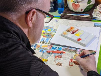 artist Jim Mellett working at his home studio