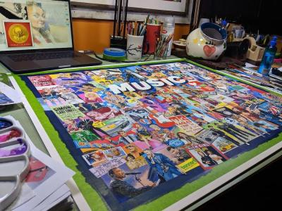 artist's drawing table including finished artwork for a jigsaw puzzle