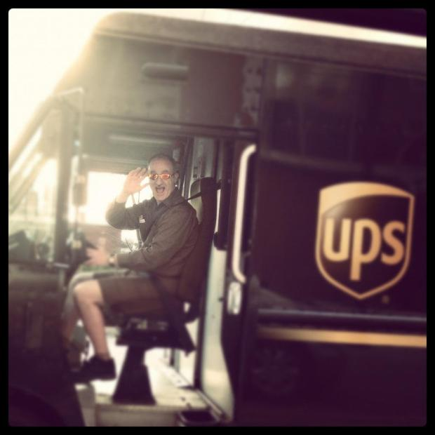 artist Jim Mellett in the driver's seat of a UPS delivery van