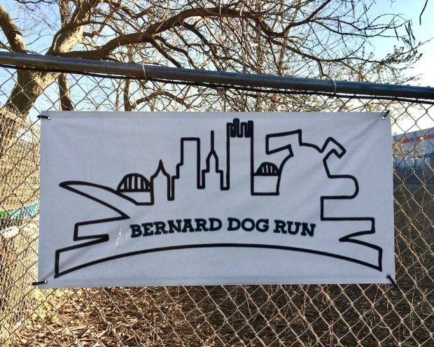 sign for Bernard Dog Run with outline of downtown Pittsburgh skyline