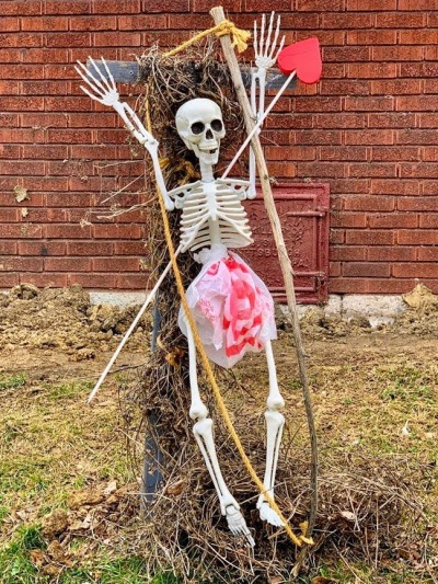 lawn decoration of plastic skeleton with red valentine prop