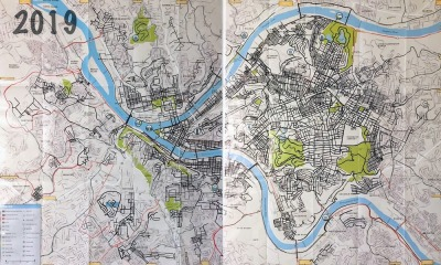 paper map of Pittsburgh with lines drawn to mark all streets walked
