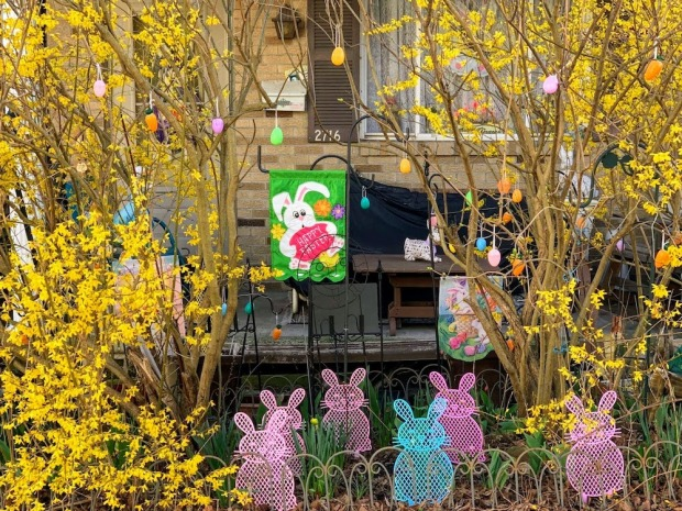house with yellow flowers and Easter decorations