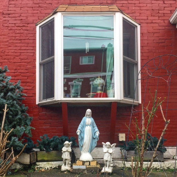 statues of Mary and angels in front yard