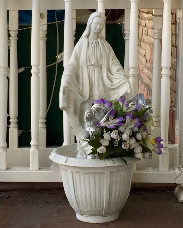 all-white statue of Mary on front porch