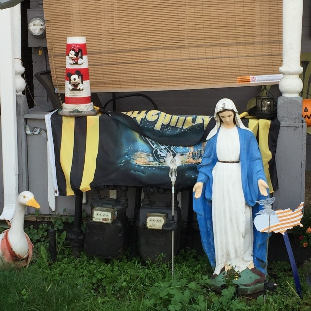statue of Mary with other lawn decorations