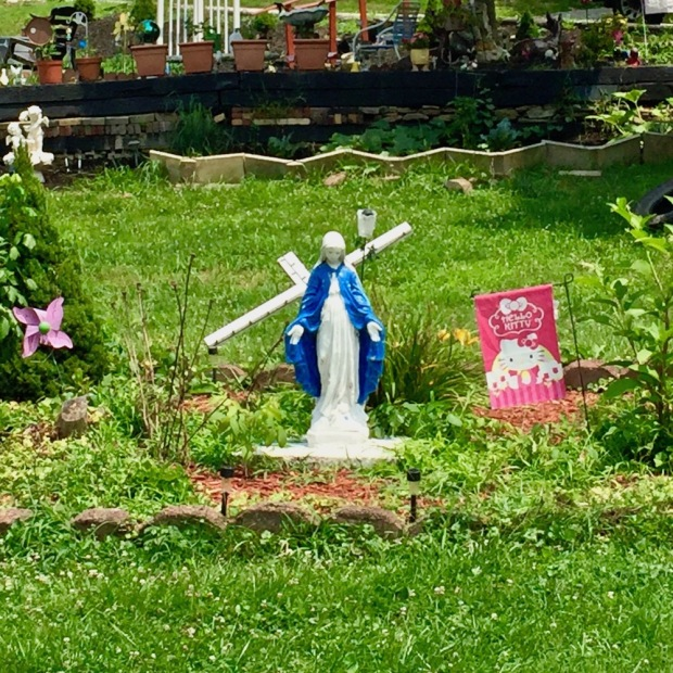 statue of Mary in large garden bed