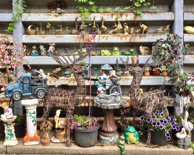 retaining wall with many model animal figures