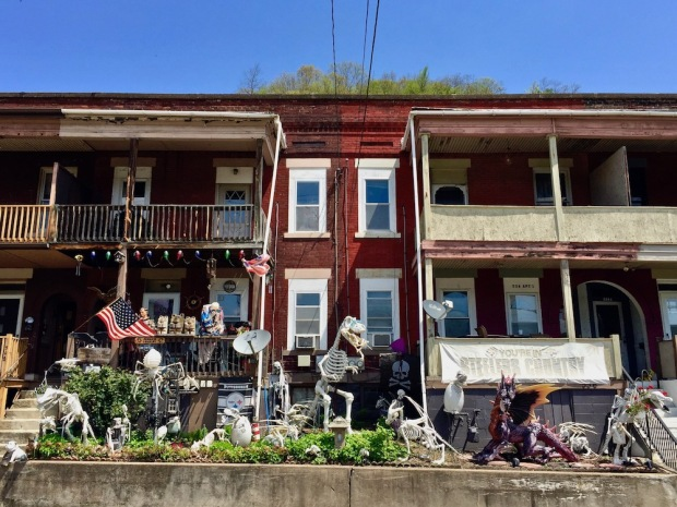 brick row house with many lawn decorations