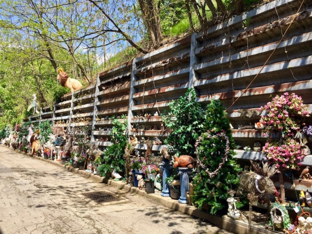 long retaining wall decorated with hundreds of organized objects