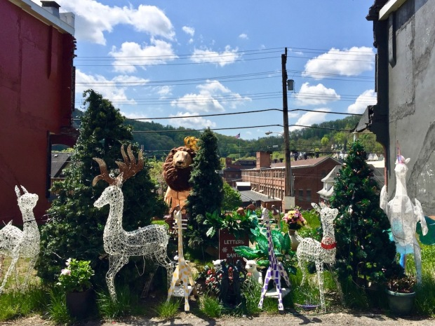 Christmas decorations in alley with view of former Westinghouse factory