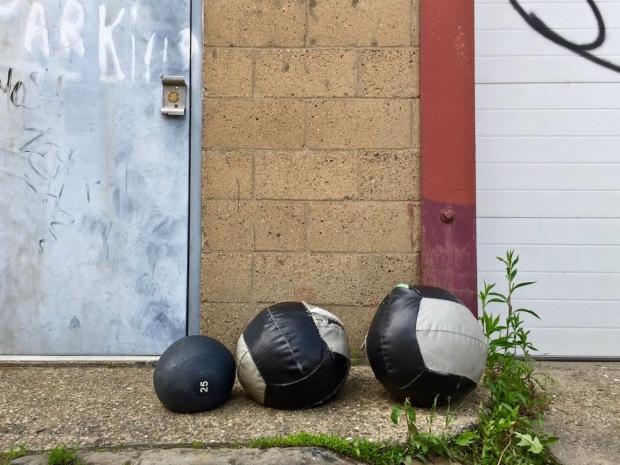 worn medicine balls left in alley
