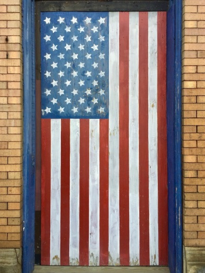 wooden doorway painted like an American flag