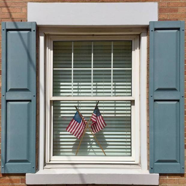 window with American flags