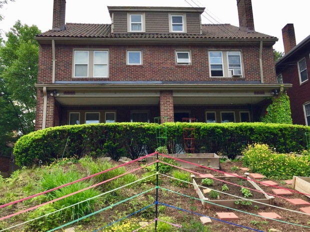 house front garden decorated with colored streamers