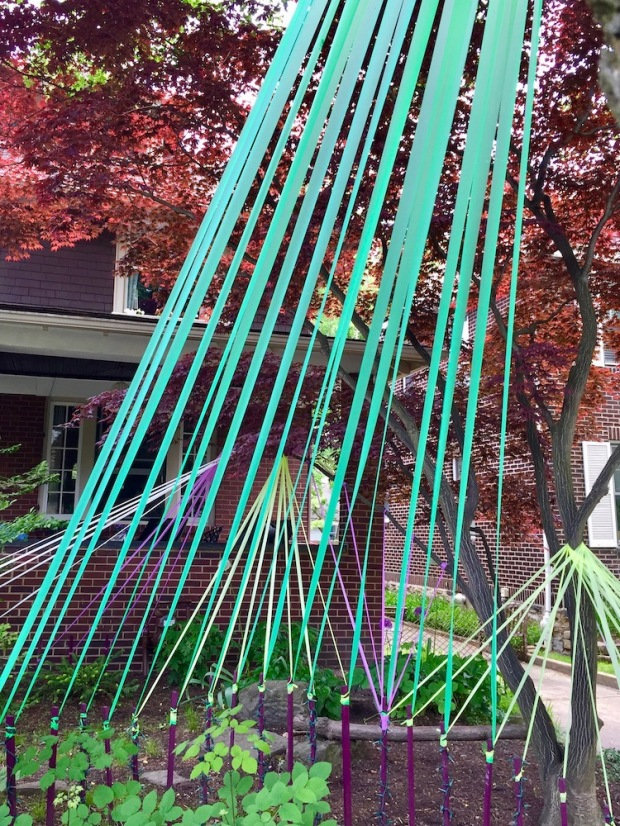 house front yard decorated with colored streamers