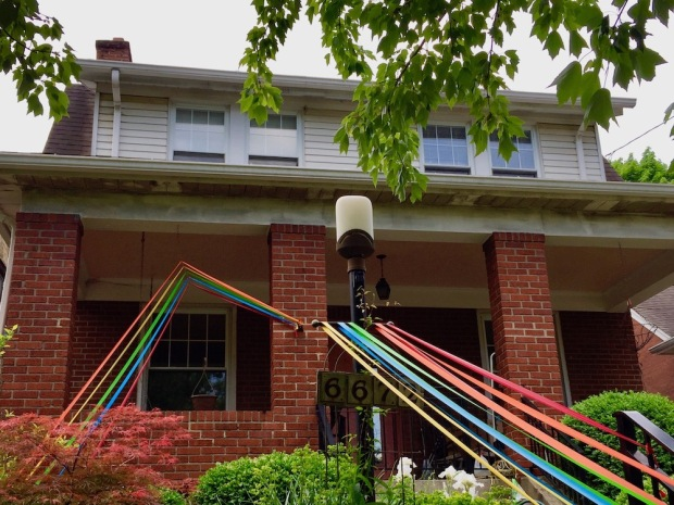 house decorated with colored streamers