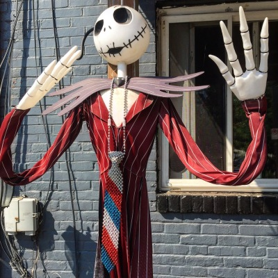 Halloween skeleton decoration wearing long dress and red, white, and blue tie