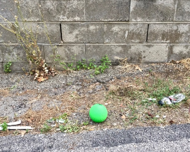 green ball left in alley