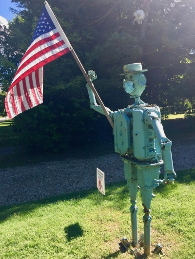 sculpture of man created with auto parts