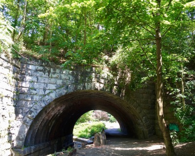 stone arch over creek and footpath