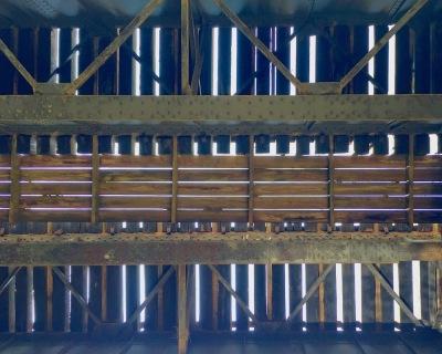 underside of old steel and wood train trestle