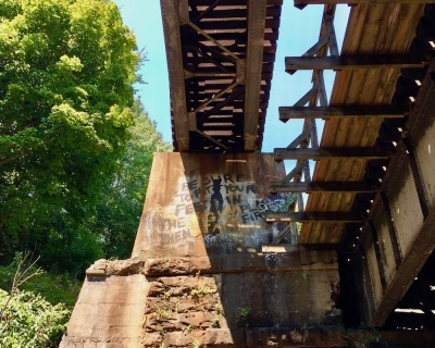 cement and steel train trestle in the woods