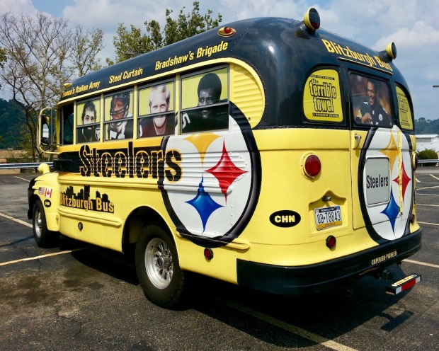 old school bus decorated in celebration of the Pittsburgh Steelers