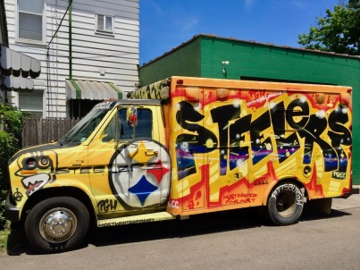 cargo van painted in celebration of the Pittsburgh Steelers