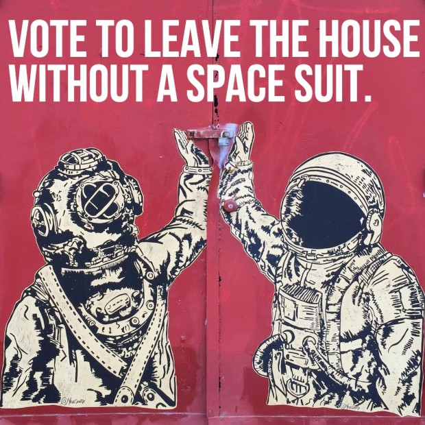 wheatpaste images of person in diving bell high-fiving person in space suit