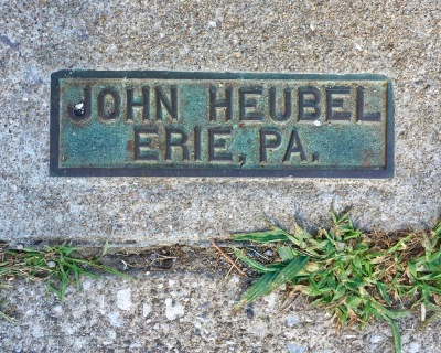 brass sidewalk plaque for John Heubel, Erie, PA