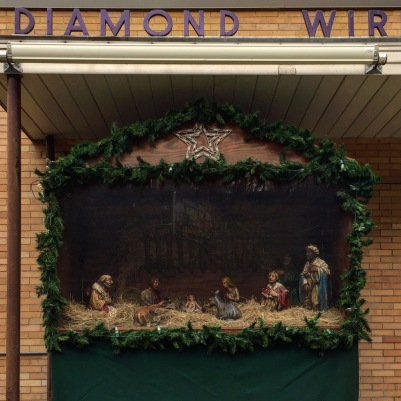 Christmas nativity scene in front of small factory