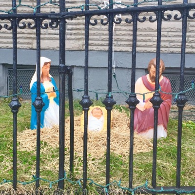 Christmas nativity scene with plastic Mary, Joseph, and baby Jesus decorations outside home