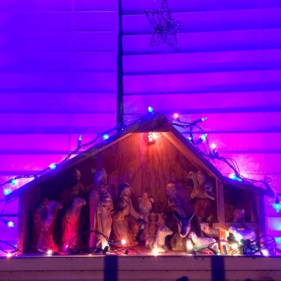 Christmas nativity scene in row house window