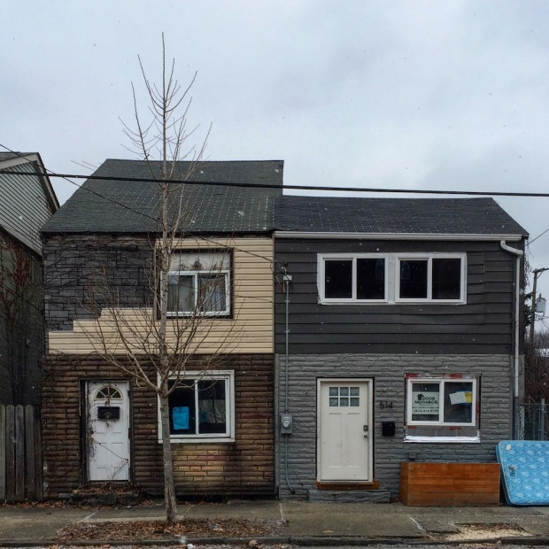 pair of row houses with very different siding treatments, Pittsburgh, PA