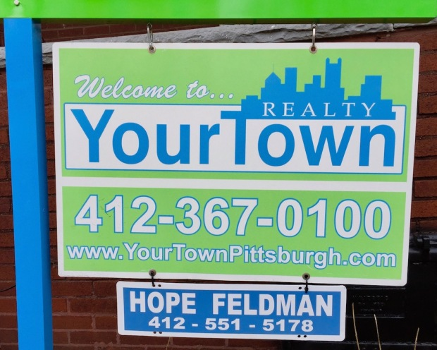 sign for Your Town Realty including the Pittsburgh skyline