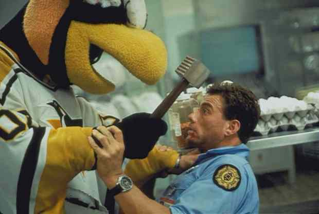 "still from film ""Sudden Death"" of Jean-Claude Van Damme fighting with Iceburgh, the Pittsburgh Penguins mascot"