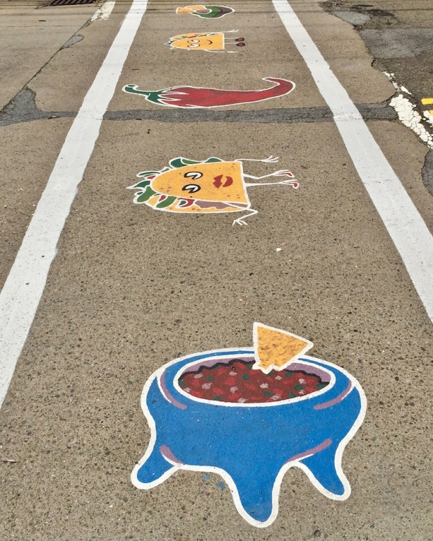 street crosswalk mural of Mexican food