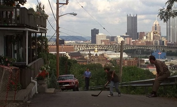 "scene from ""Sudden Death"" featuring steep Pittsburgh street with city skyline in the background"