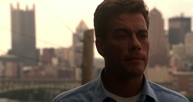 "scene from ""Sudden Death"" with actor Jean-Claude Van Damme against the Pittsburgh city skyline"