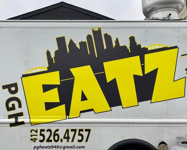PGH EATZ food truck logo including silhouette of the Pittsburgh skyline