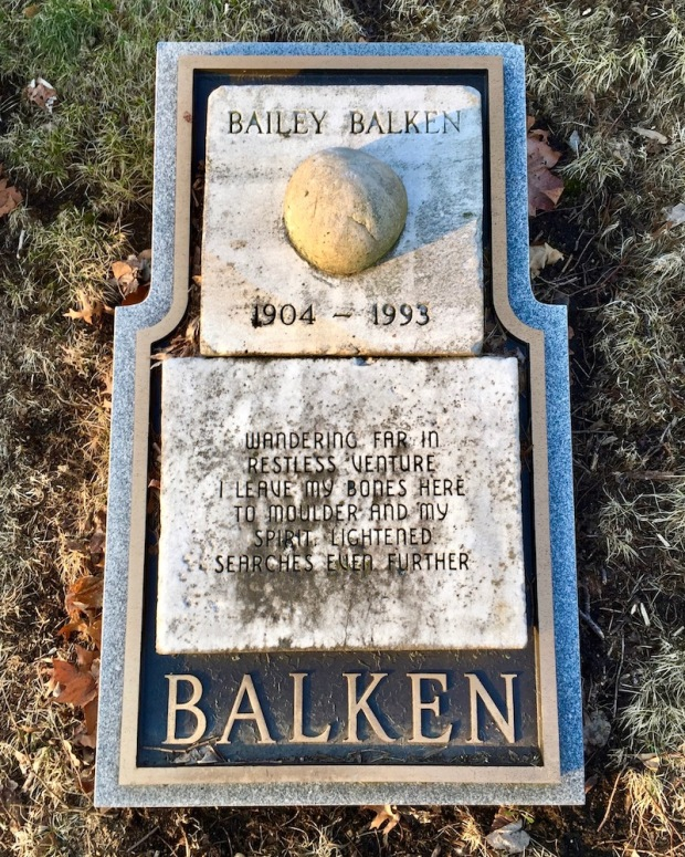 grave marker featuring odd, round, ball-like stone