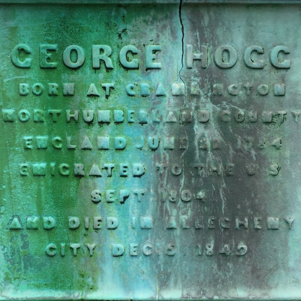 detail from George Hogg's grave monument, colored green by oxidized copper in the stone