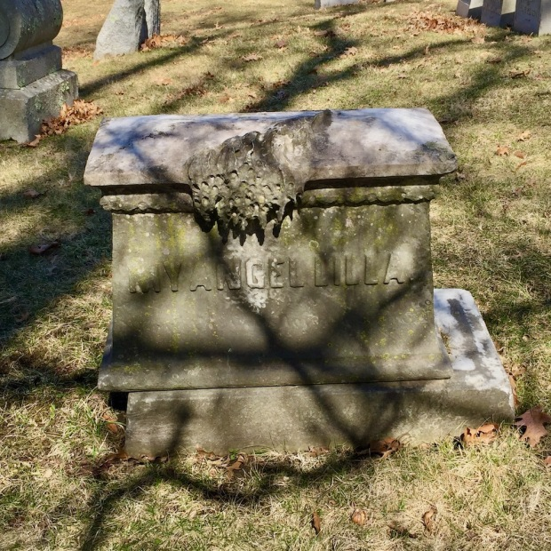 stone grave marker that appears to appears to be melting